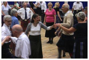 People enjoying Scottish Dancing